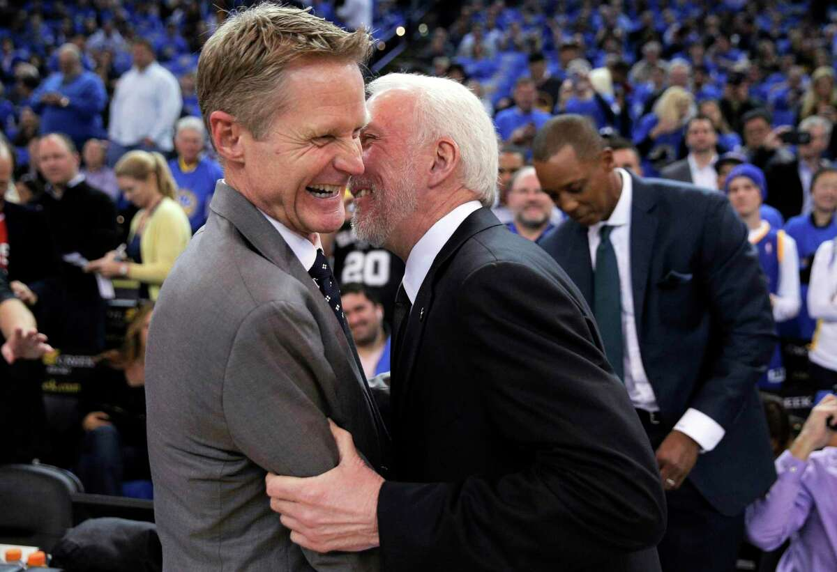 Normally rivals, Spurs head coach Gregg Popovich (right) and Warriors head coach Steve Kerr will guide the U.S. men's Olympic basketball team.
