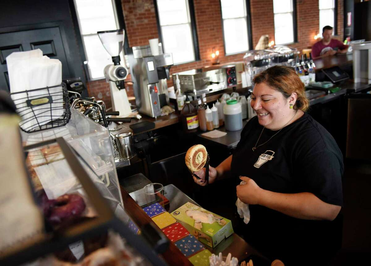 Tara Camiglio works the counter on July 1, 2021, at the new Third Place by Half Full Brewery tasting room and cafe in Stamford, Conn.
