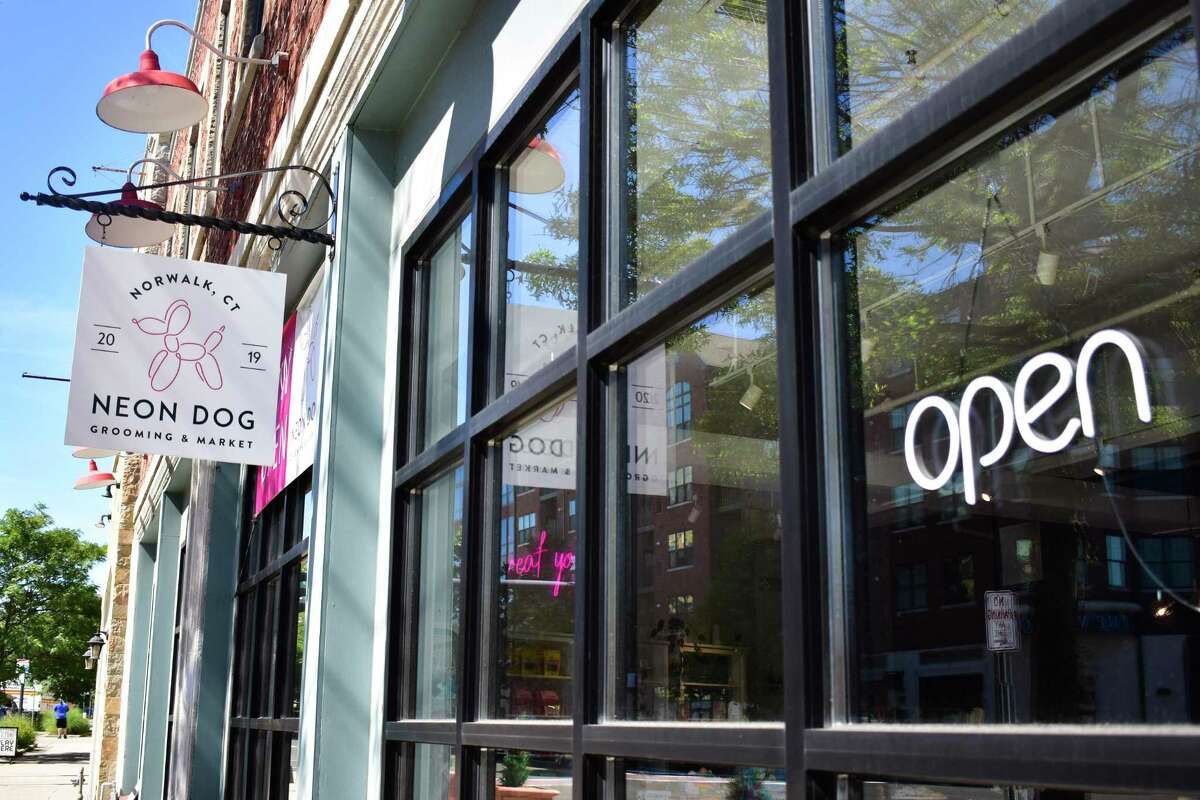 A sign proclaims Neon Dog open for business in late June 2021 in Norwalk, Conn.
