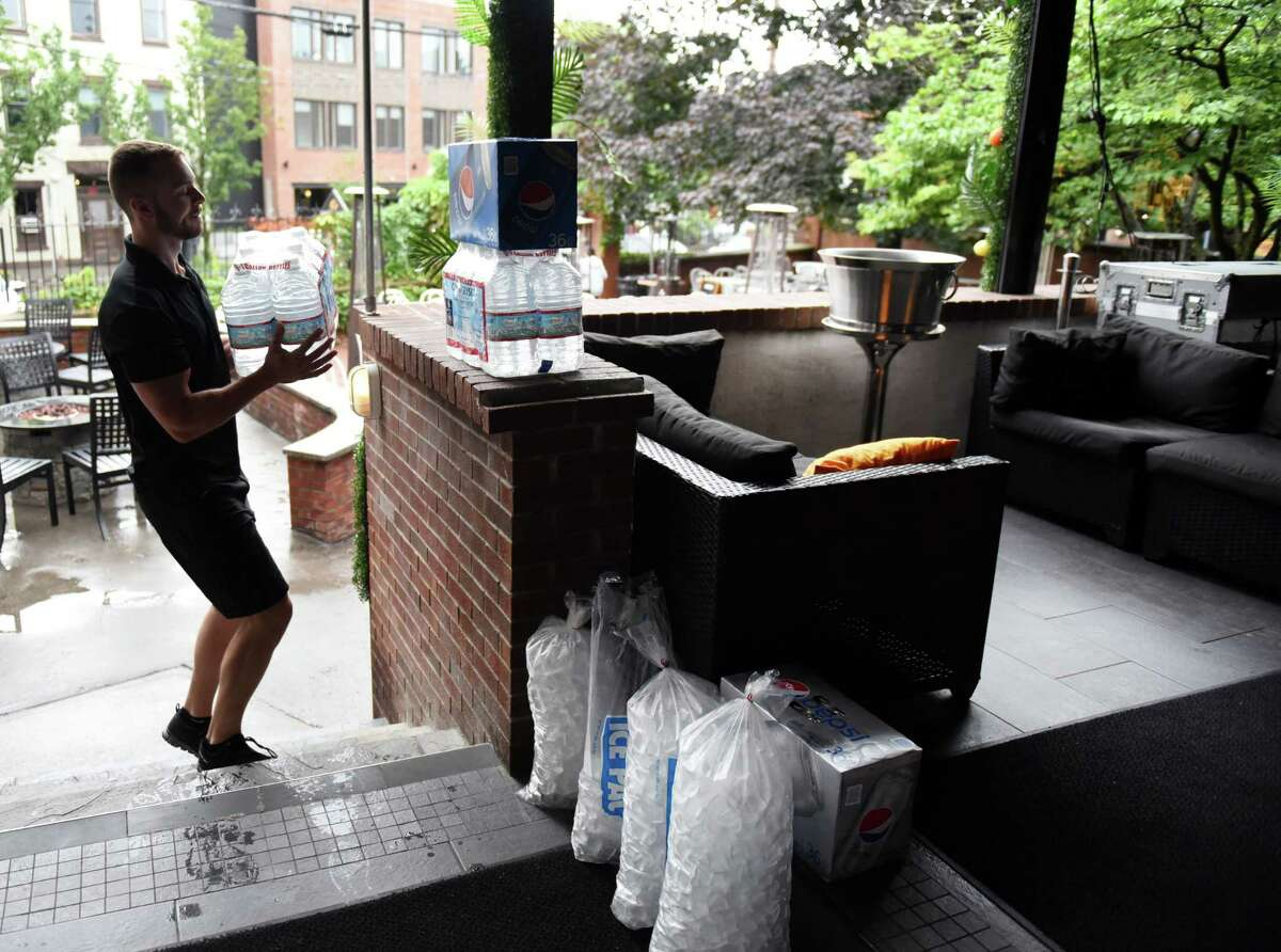Bartender Christian Stearns had to haul bottled water, cans of soda and ice into Gaffney's Restaurant Friday after a boil water order went into effect for the entire city. On Saturday afternoon, the order was lifted.(Will Waldron/Times Union)