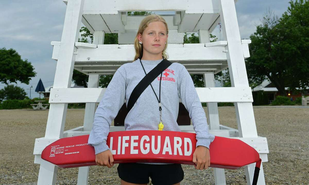 Morgan Saunders, a lifeguard at Calf Pasture Beach, Thursday, July 1, 2021, in Norwalk, Conn. Saunders rescued and resuscitated a 9 year old drowning victim at the beach earlier in the week.