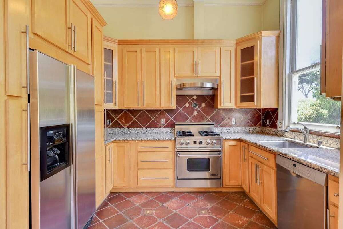 The kitchen isn't huge, but it has stainless steel appliances that look fairly new and it has a dishwasher. No word on a garbage disposal. A large kitchen window also overlooks the park.