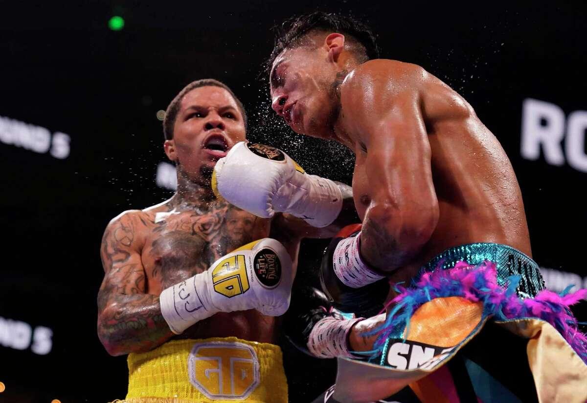 Gervonta Davis, left, hits Mario Barrios during the WBA Super Lightweight world championship boxing match on Saturday, June 26, 2021 in Atlanta. Davis won. (AP Photo/Brynn Anderson)