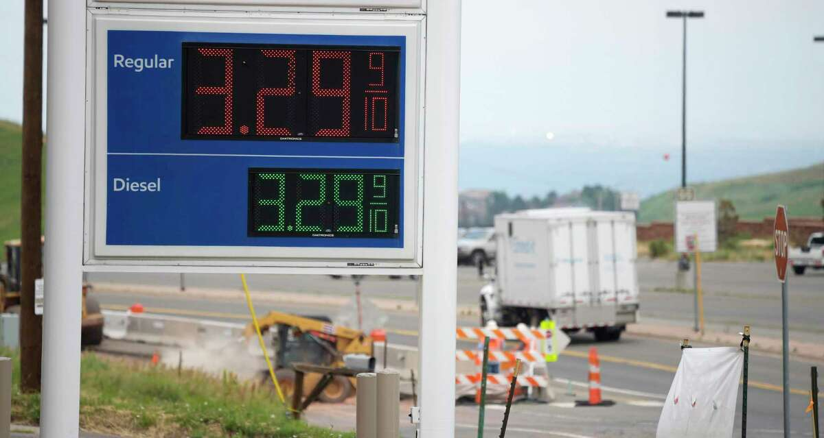 The price-per-gallon of gasoline is displayed on a sign as motorists head east along a frontage road parallel to Interstate 70 to get an early start on the Fourth of July holiday weekend Thursday, July 1, 2021, near Golden, Colo. With COVID restrictions being eased, travelers are expected to be on the roads in spite of gasoline prices topping the $4-mark across the country. (AP Photo/David Zalubowski)