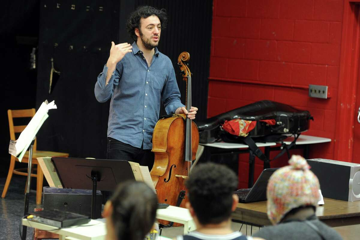 Eric Jacobsen, Conductor and Music Director for the Greater Bridgeport Symphony, speaks to students at Central High School, in Bridgeport, Conn. March 9, 2016. Jacobsen will lead the symphony this Saturday at the Klein Memorial when they perform Gustav Mahler's 5th Symphony.