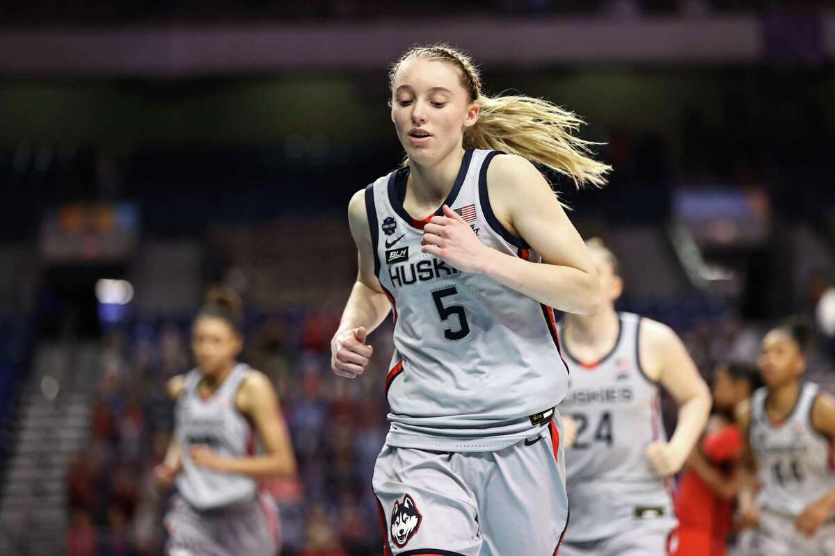 SAN ANTONIO, TEXAS - APRIL 02: Paige Bueckers #5 of the UConn Huskies runs off of the court after losing to the Arizona Wildcats in the Final Four semifinal game of the 2021 NCAA Women's Basketball Tournament at the Alamodome on April 02, 2021 in San Antonio, Texas. (Photo by Elsa/Getty Images)