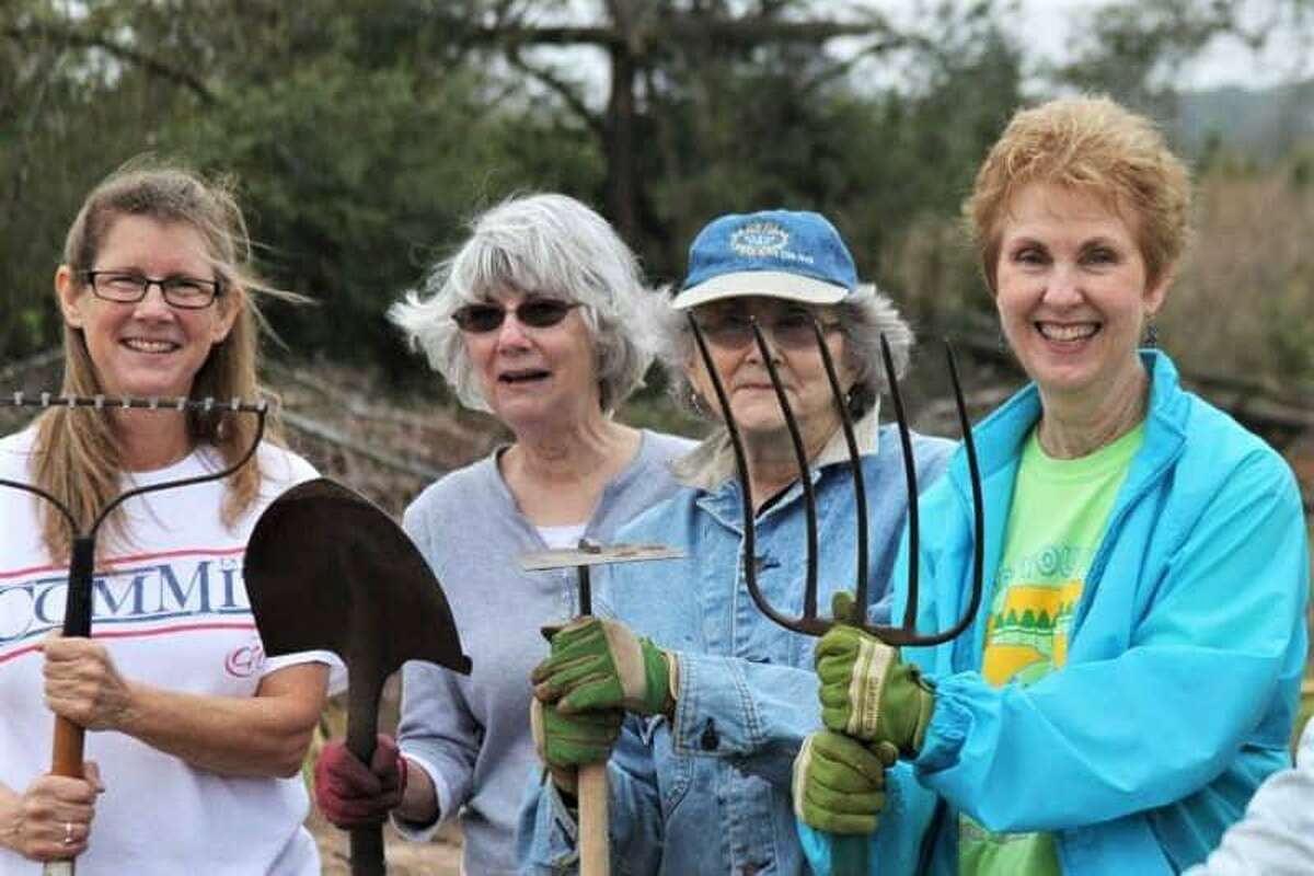 Volunteers at the Tomball community garden, which provides produce to Tomball Emergency Assistance Ministries.