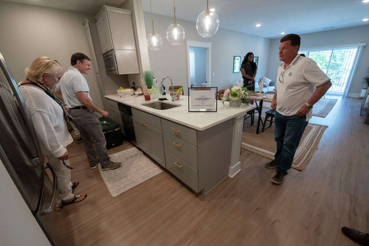 People take a tour of a two bedroom apartment in the new Landmark apartments located on Fuller Road on Wednesday, June 23, 2021 in Albany, N.Y. (Lori Van Buren/Times Union)