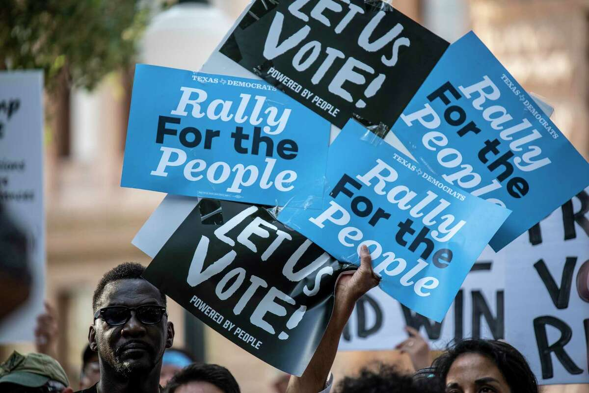 Protesters rally outside the Texas Capitol last month to challenge Senate Bill 7, which would limit absentee voting, decrease the number of polling places and encourage purging of voters from the rolls.