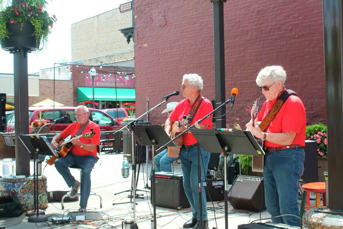The Pocket Park music series hosted Peter Jordan and His Fun-Lovin' Crowd entertained audiences in downtown Big Rapids on Friday, July 2. (Pioneer photo/Olivia)