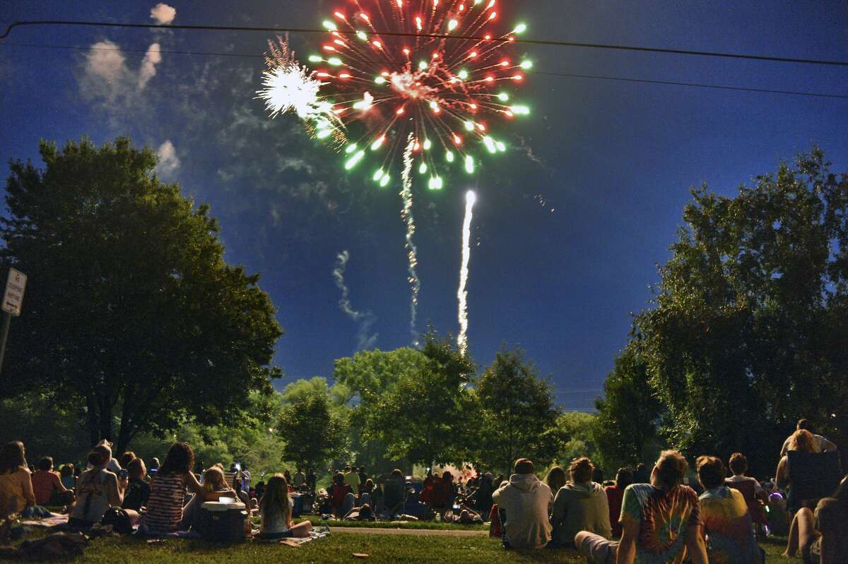 Crowds line the banks of the Mohawk River in Scotia for a Fourth of July fireworks show in 2018.