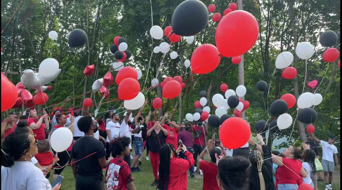 Balloons rise over the Joseph Sauer Memorial Park on Beaver Street in Danbury during a memorial service for Yhameek Johnson on Monday, June 21, 2021. Police said the 18-year-old was killed in a drive by shooting the night before.