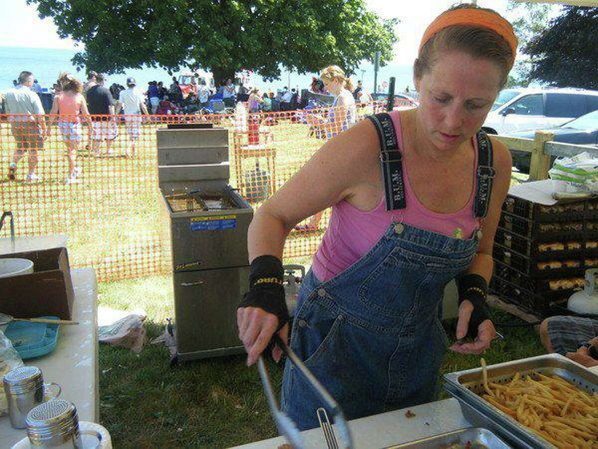 Kelly Cummings works the food tent during Woodmont Day.