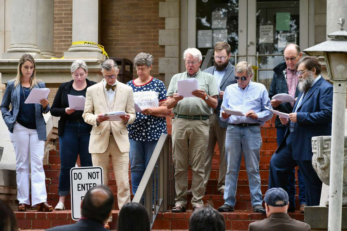 Several local attorneys and citizens - and Mayor Charles Starnes - gathered at the Hale County Courthouse on Friday for the annual reading of the Declaration of Independence in celebration of the Fourth of July.