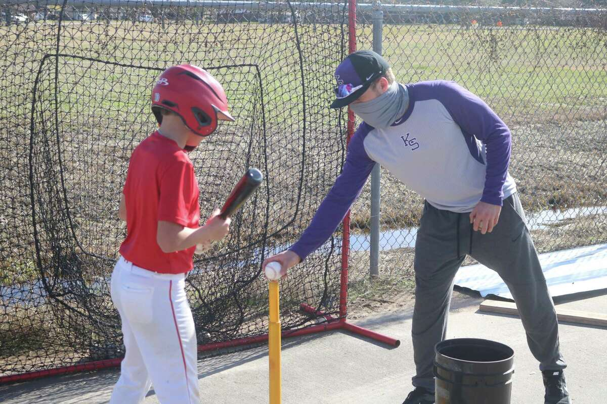 Kansas State's Cameron Thompson tees up a baseball for a youngster during the Holiday Baseball Camp last December at Jim Kethan Field. Thompson was recently named to the Academic All-Big 12 Baseball Team, capturing First Team honors for a 3.20 GPA or better.