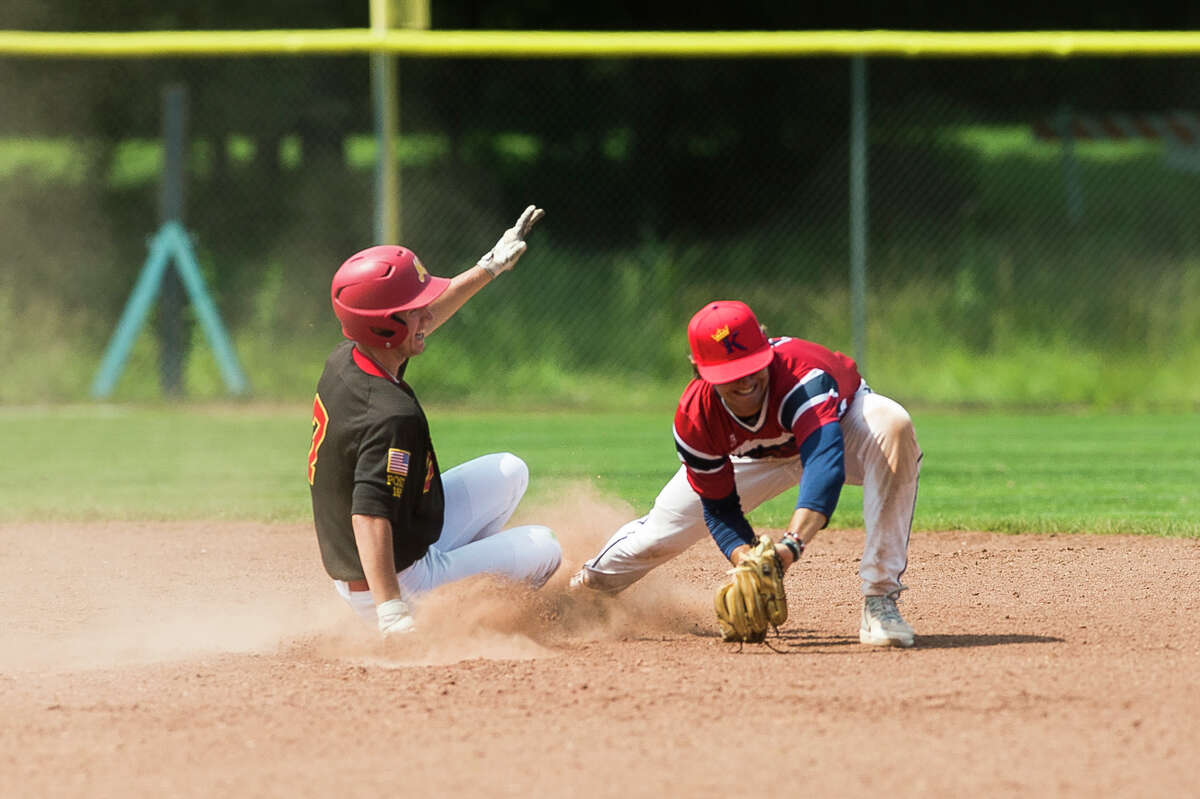Berryhill's Danny Witbeck slides into second base during a game against the Capitol City Kings in the Gabby Mills July Fourth Invitational Friday, July 2, 2021 at Northwood University. (Katy Kildee/kkildee@mdn.net)
