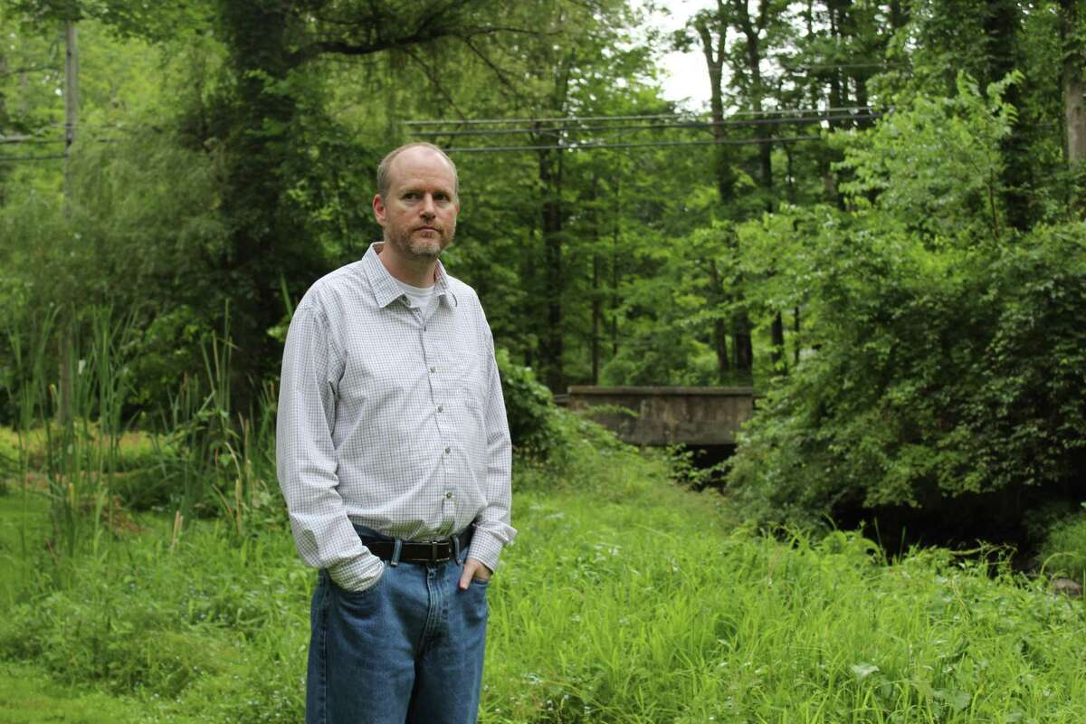 Chris Hopkins lives along the Ridgefield Brooke at 91 Great Hill Road. His property would be adversely impacted if the state decides to move with decommissioning a dam near Fox Hill Condominiums.