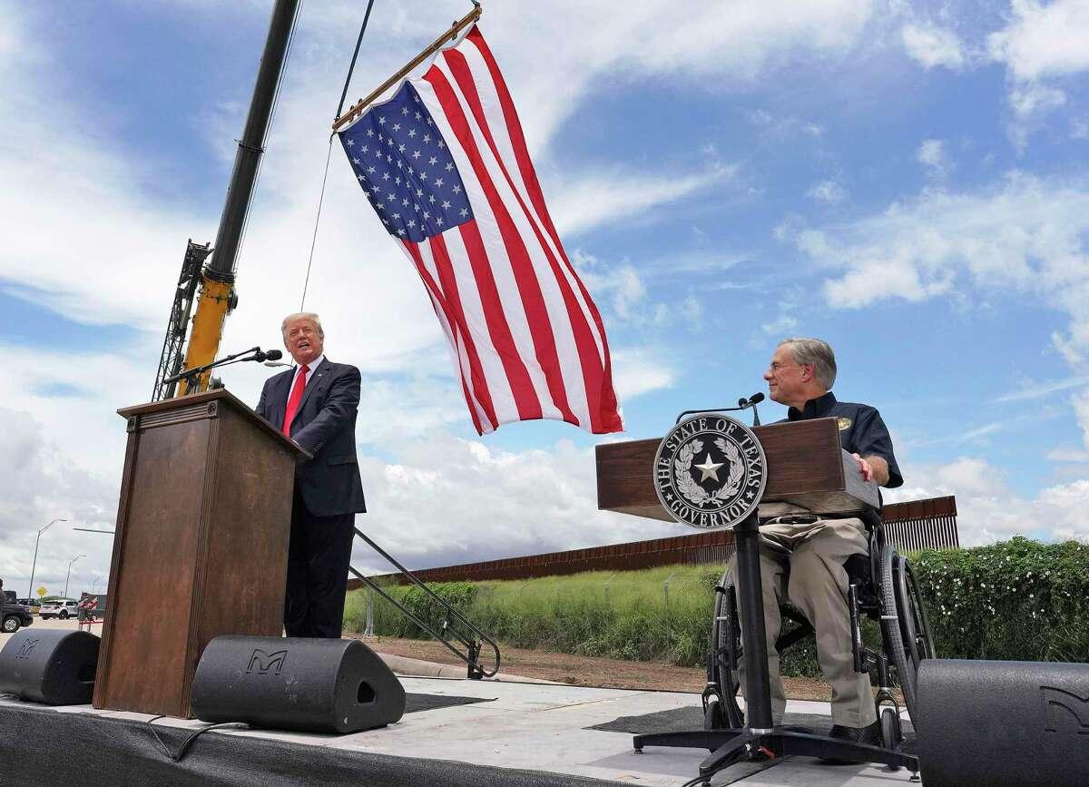 Former President Donald Trump and Texas Gov. Greg Abbott speak near a section of the border wall on Wednesday, June 30, 2021, in Pharr, Texas. (Joel Martinez/The Monitor via AP)