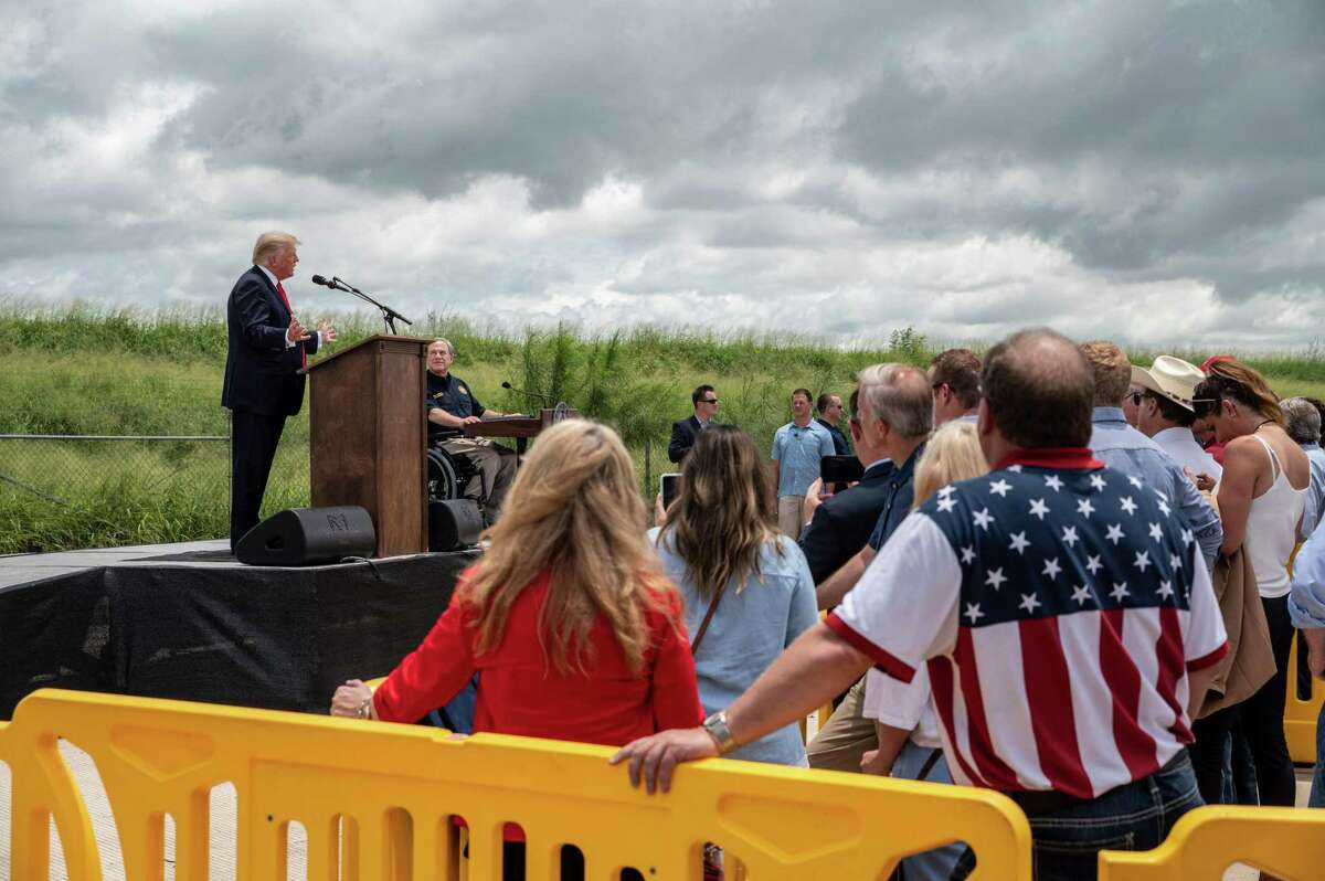 Former US President Donald Trump (L) speaks, flanked by Texas Governor Greg Abbott, during a visit to the border wall near Pharr, Texas on June 30, 2021. - Former President Donald Trump visited the area with Texas Gov. Greg Abbott to address the surge of unauthorized border crossings that they blame on the Biden administration's change in policies. (Photo by Sergio FLORES / AFP) (Photo by SERGIO FLORES/AFP via Getty Images)