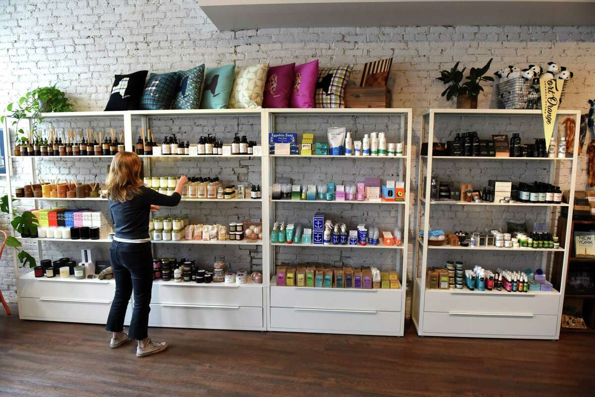 Elizabeth Schanz, assistant manager at Fort Orange General Store, preps the shelfs at the Broadway retail store on Friday, July 2, 2021, in Albany, N.Y. (Will Waldron/Times Union)