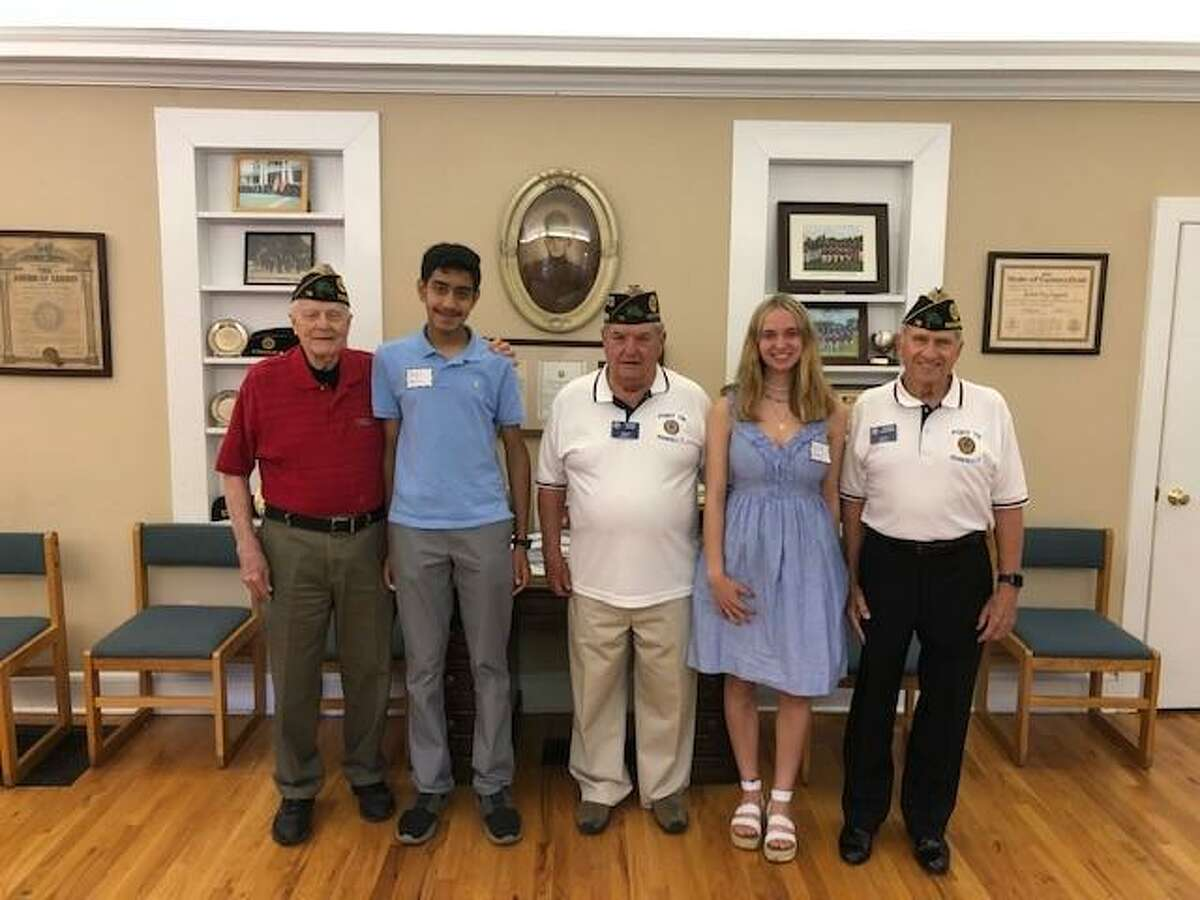 The Ridgefield Everrett Raymond Seymour American Legion Post 78 in Ridgefield has named Ridgefield High School senior students Arav Patel, and Julia Grey as the first place winners of its 2021 Legion essay contest. In the picture are: Dr. John K. Fisher, who is the chair of the contest, Patel, George Besse, post commander, Grey, and George Schuster, post adjutant.