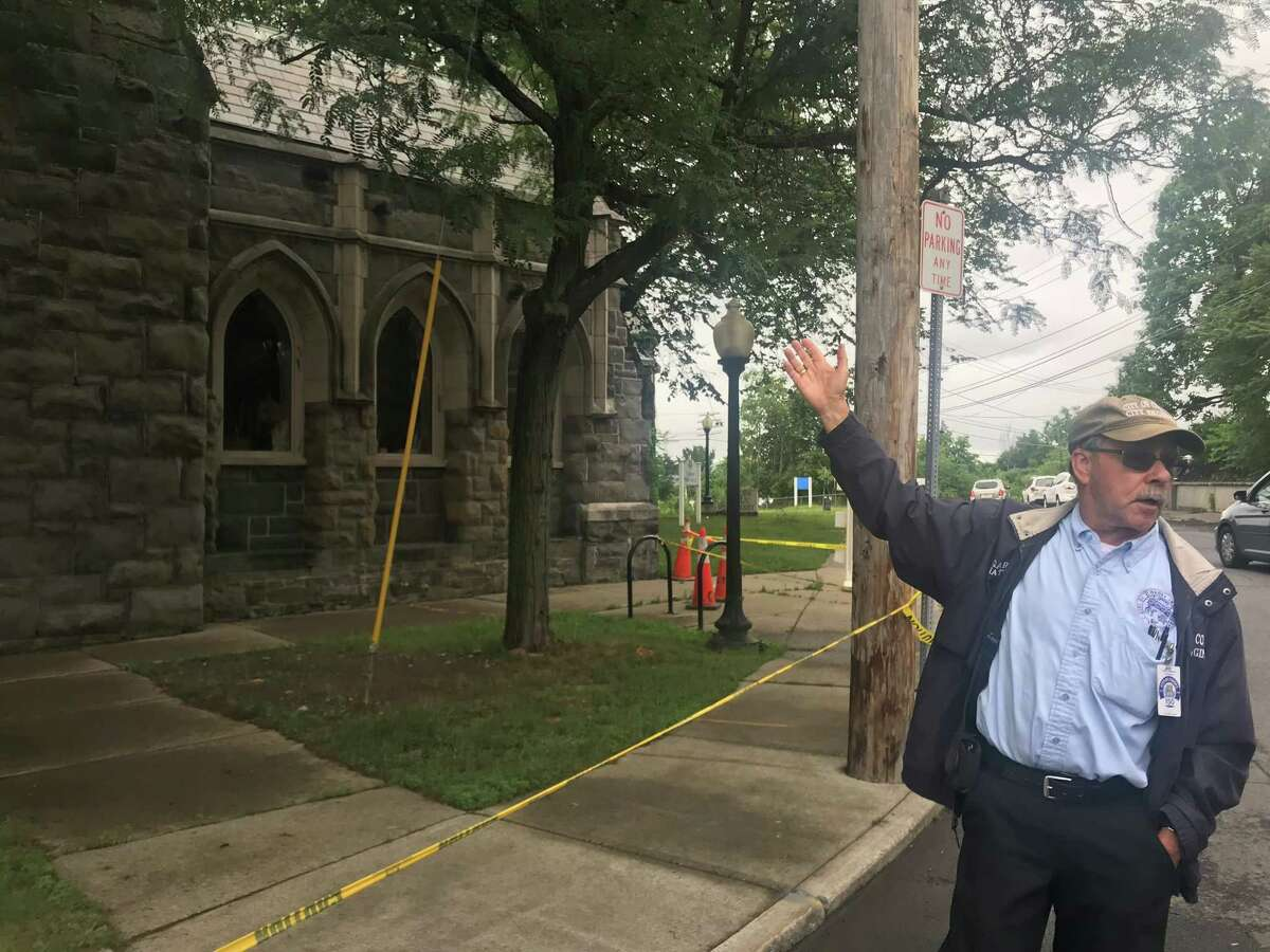 Cohoes City Engineer Garry Nathan points to the damaged Cohoes Public Library in Cohoes, N.Y. on Friday July 2, 2021.