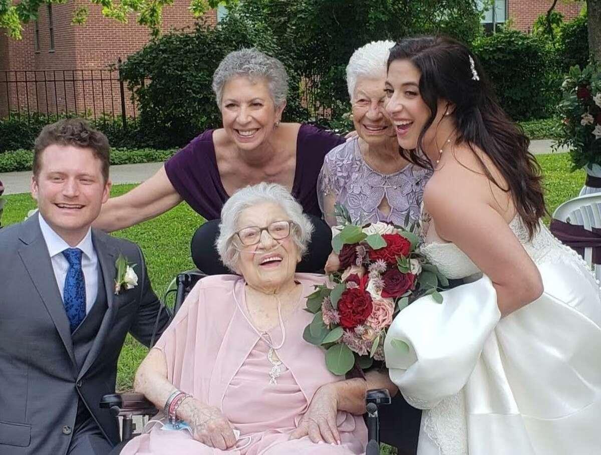 Nicholas Hann, the groom; Angela Carino, mother of the bride, in purple; Domenica 'Dolly' Sarica, grandmother of the bride in lilac; and Elizabeth Carino, the bride, flank Frances Carino, grandmother, center.