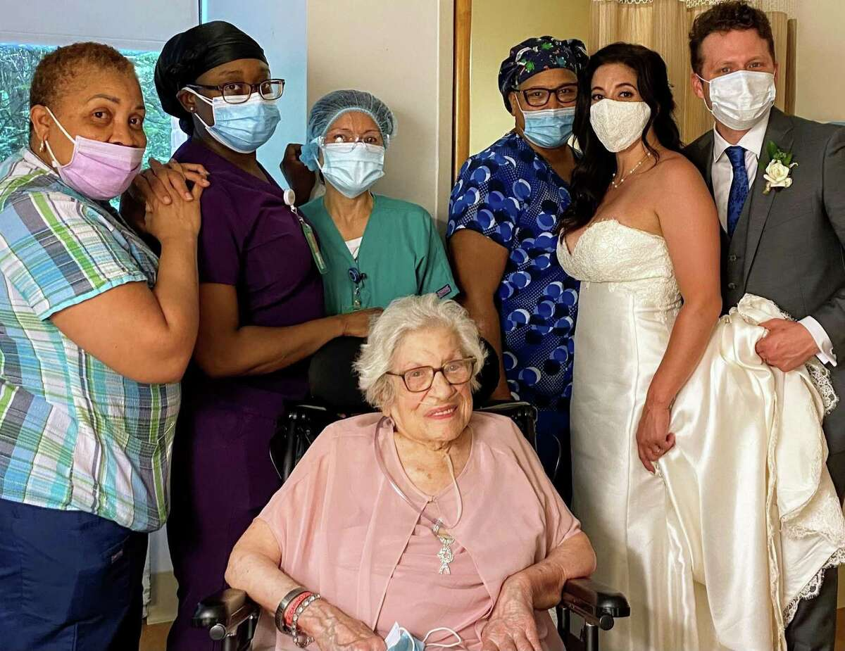 Elizabeth Carino and Nicholas Hann offer their thanks to the nurses at the Nathaniell Witherell Home for their help in getting Frances Carino, the bride's grandmother, ready for a big celebration, and took a photo with them.