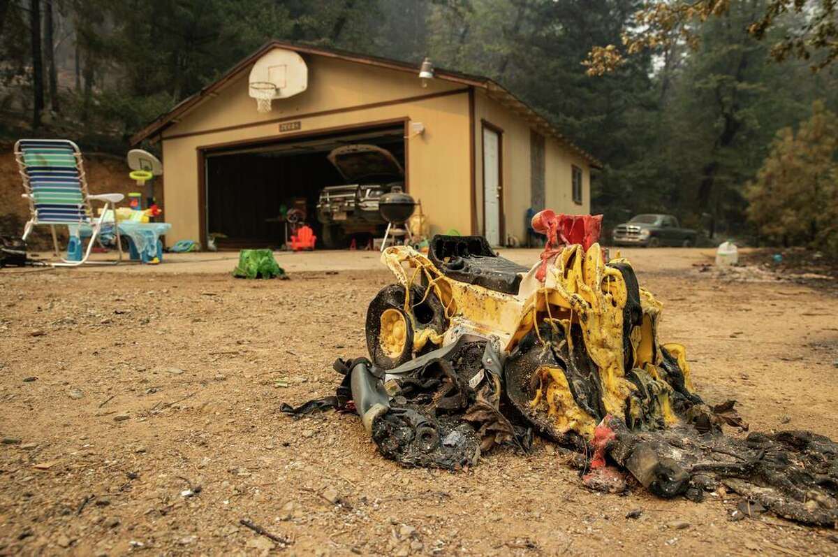 A melted toy car near a property damaged by the Salt Fire east of Interstate 5 near Lakehead.