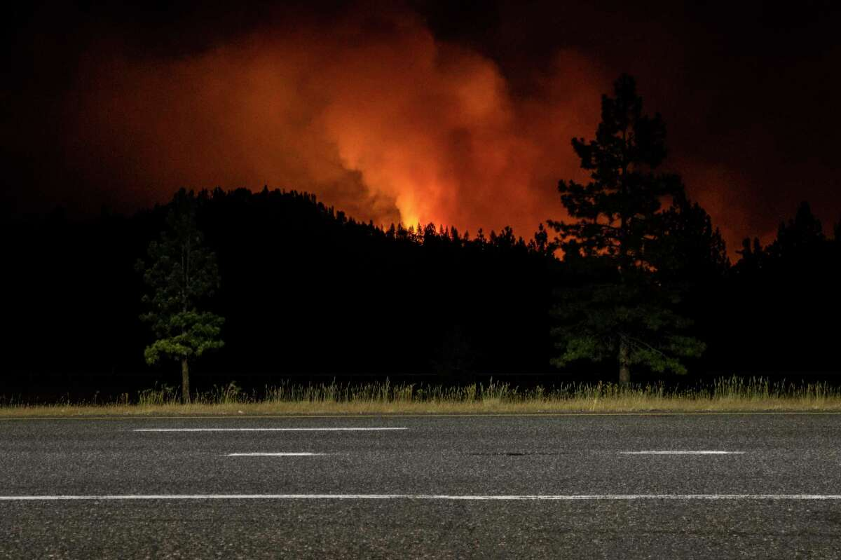 The Salt Fire is seen burning Thursday in the mountains in a long exposure photograph near Lakehead.