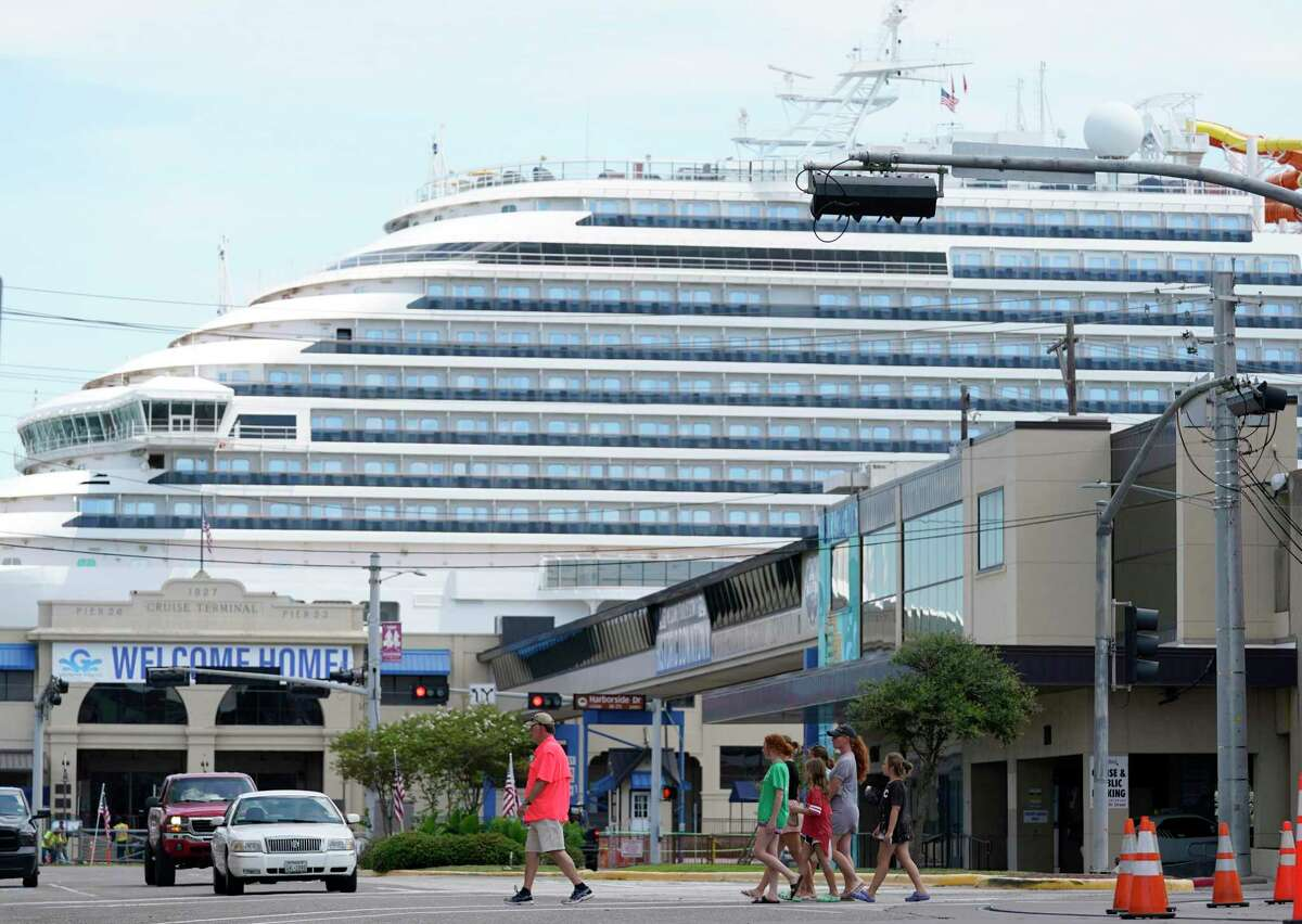 The Carnival Vista is shown at the Port of Galveston as traffic and people move along 25th St. Friday, July 2, 2021 in Galveston. The Carnival Vista will be the first cruise to sail out of Galveston since the pandemic.