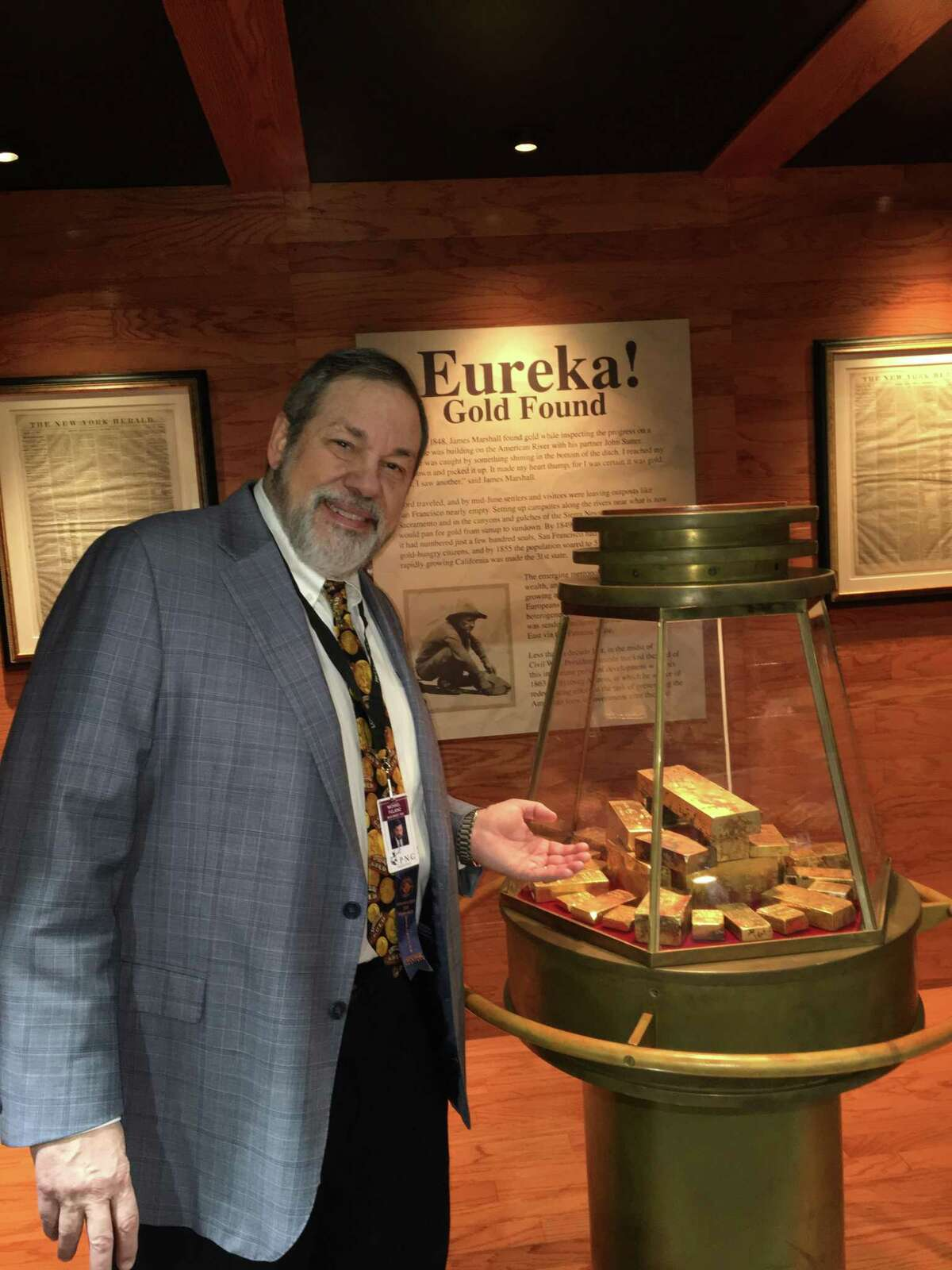 """Michael Fuljenz, president of Universal Coin & Bullion in Beaumont, with some of the historic California Gold Rush assayers' ingots recovered in 2014 from the fabled """"Ship of Gold,"""" theSS Central America, which sank in 1857. Photo credit: Donn Pearlman"""