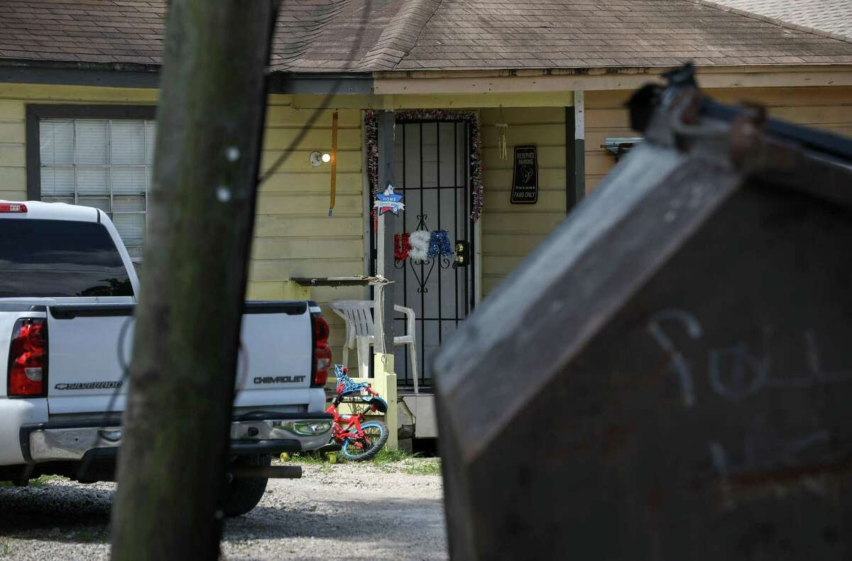 A USA decoration made of tinsel decorates a door of a home Tuesday, June 8, 2021, at 1704 Warwick Rd. in Houston. Court documents detail how the March 2020 abduction of a woman from a nearby bar led police to raid the home and discover a human-smuggling operation.