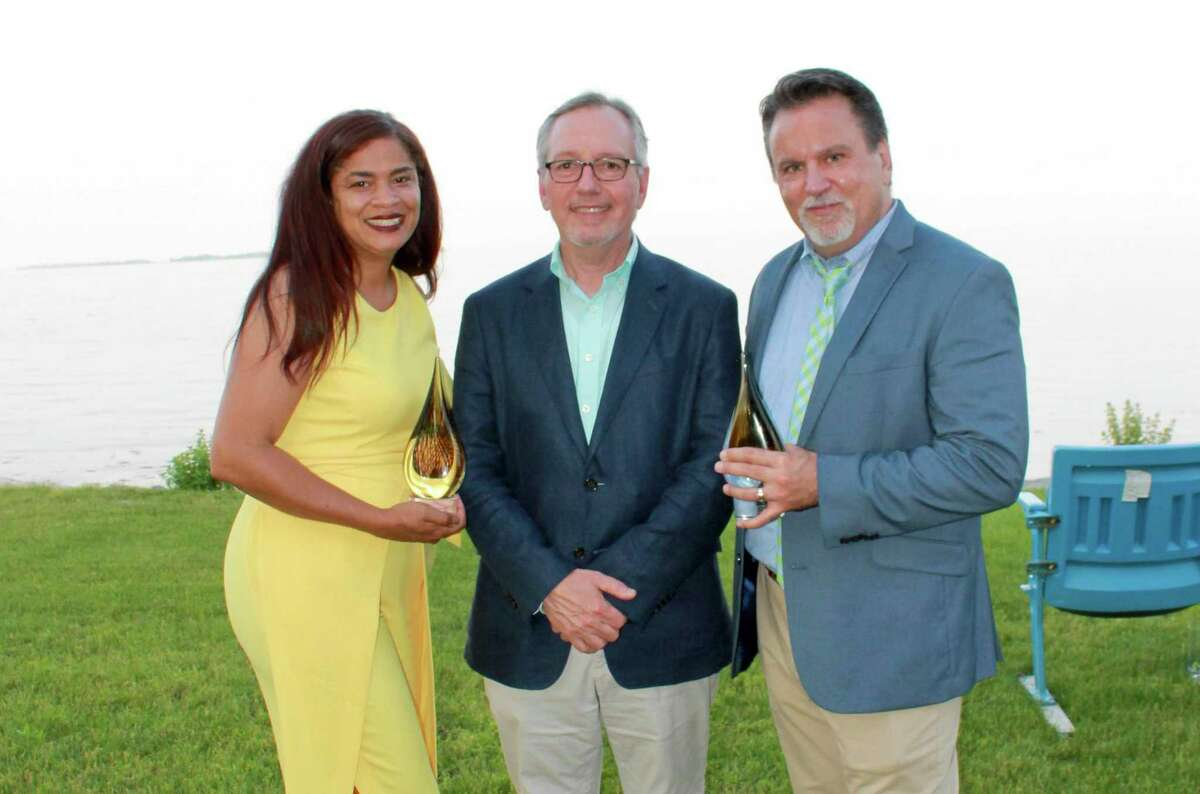 Family Centers' CEO Bob Arnold, center, with Yenny Disla-Toone, left, and Dennis Torres, right. Family Centers presented Disla-Toone and Torres with the inaugural Janet Hennessey Dilenschneider Excellence in Leadership Award in a ceremony at the Darien home of the award's namesake and her husband, Bob, on June 7.
