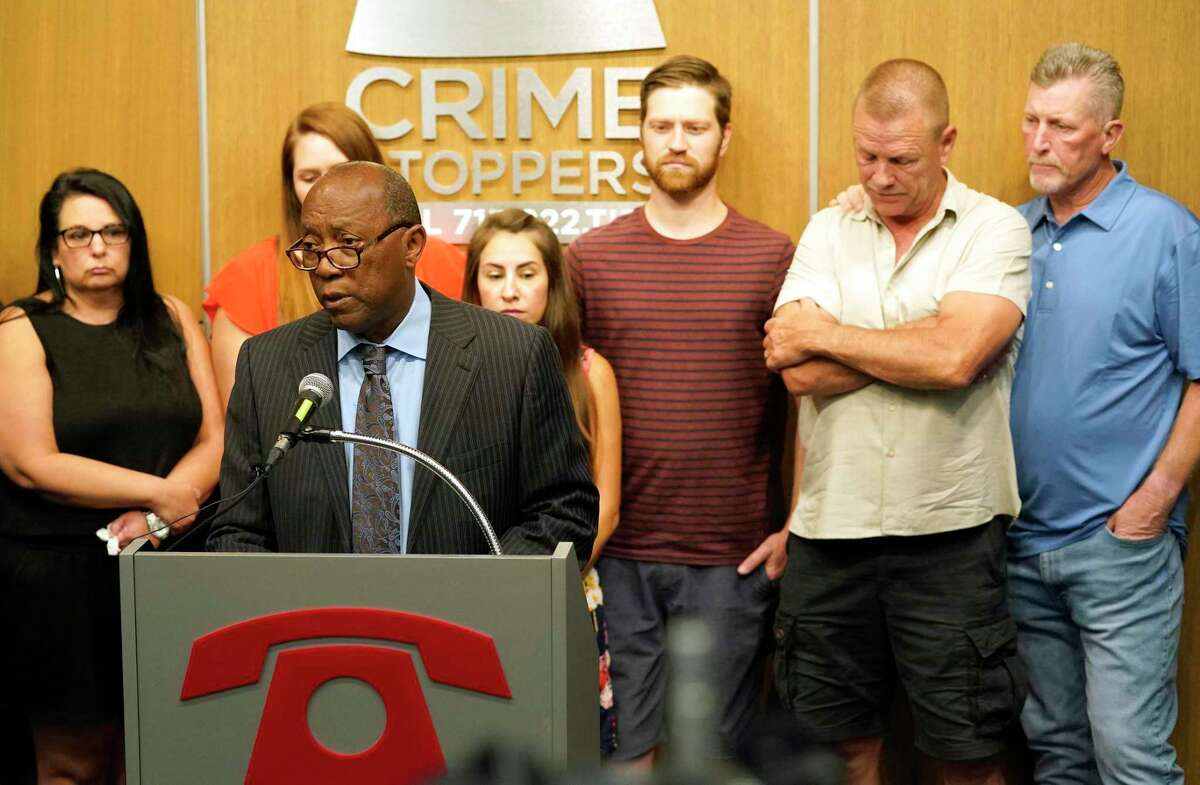 The family of Elsa Mikeska stands behind Houston Mayor Sylvester Turner as he speaks at Crime Stoppers, 3001 Main St., Monday, June 21, 2021 in Houston about her murder. Elsa Mikeska was killed last Thursday on her way to the gym.