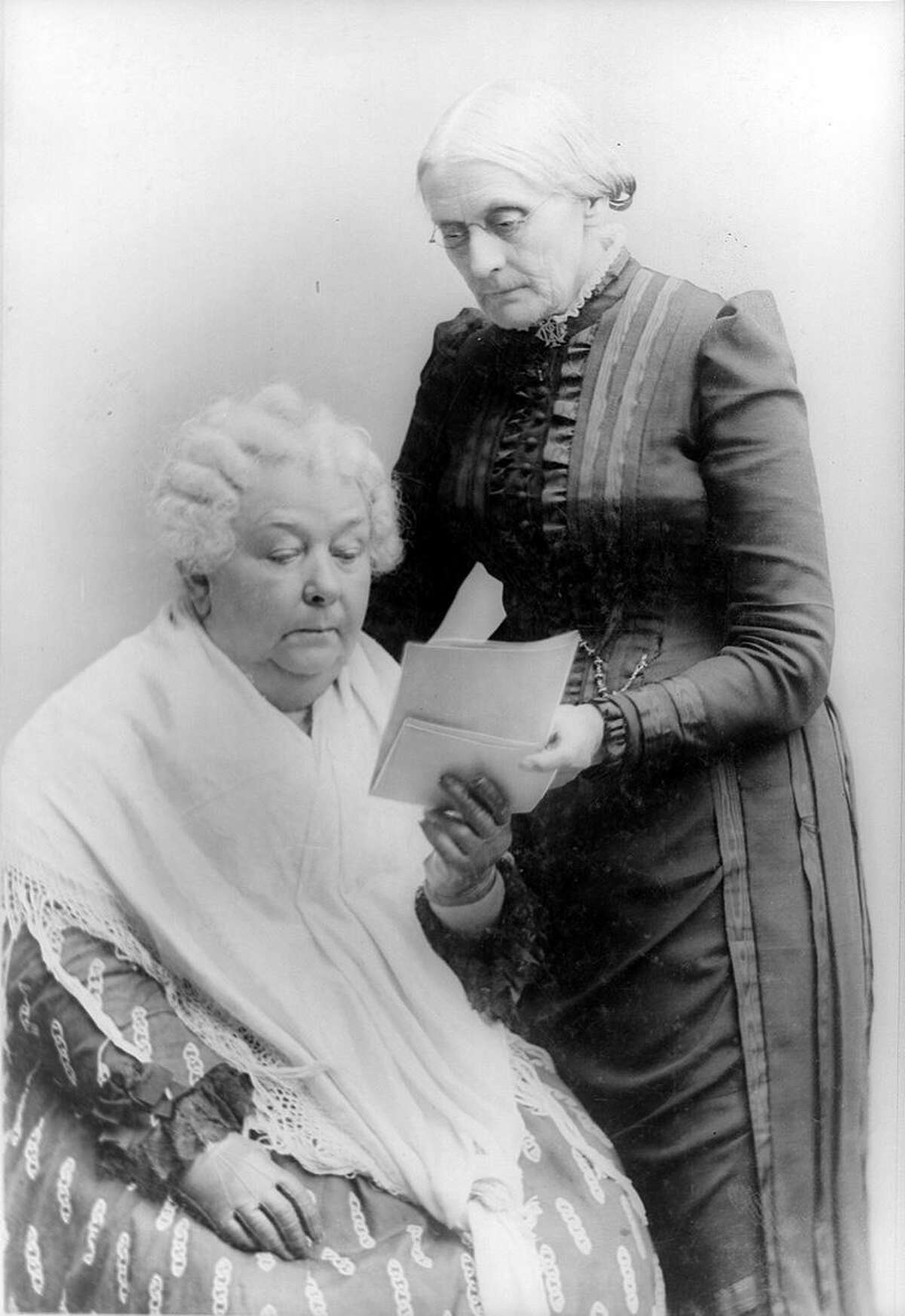 Elizabeth Cady Stanton, seated, and Susan B. Anthony, standing, both attended the first Women's Rights convention held in Seneca Falls, New York, in July of 1848. Seen here, photographed together, sometime between 1880 and 1902.