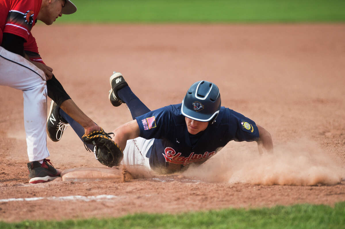 Gladwin's Chase Raymond slides back into first base during a game against the Detroit Warriors in the Gabby Mills July Fourth Invitational Friday, July 2, 2021 at Northwood University. (Katy Kildee/kkildee@mdn.net)