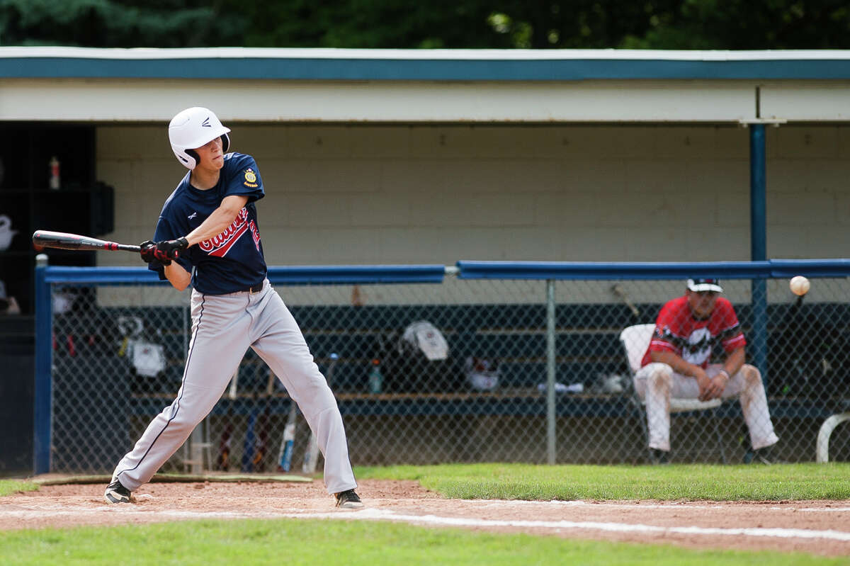 Gladwin's Carson Oldani swings on a pitch during a game against the Detroit Warriors in the Gabby Mills July Fourth Invitational Friday, July 2, 2021 at Northwood University. (Katy Kildee/kkildee@mdn.net)