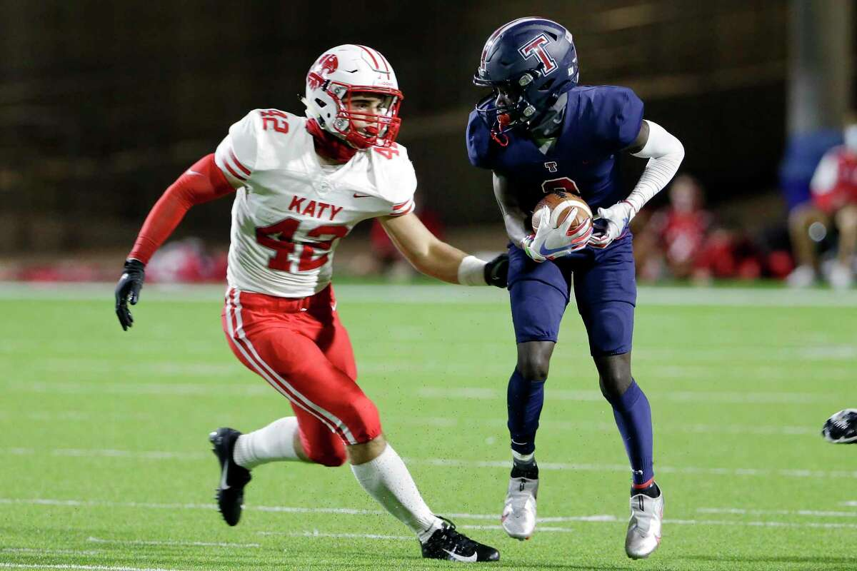 Tompkins receiver Joshua McMillan, right, pulls down a reception in front of Katy defender Ty Kana (42) during the first half of a high school football game at Legacy Stadium Thursday, Nov. 5, 2020 in Katy, TX.