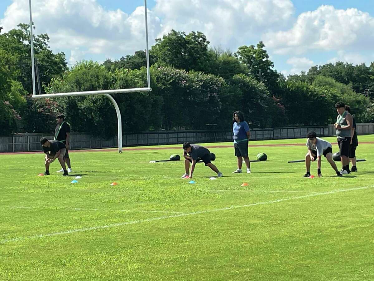 Northbrook football players work during sport-specific instruction on July 1