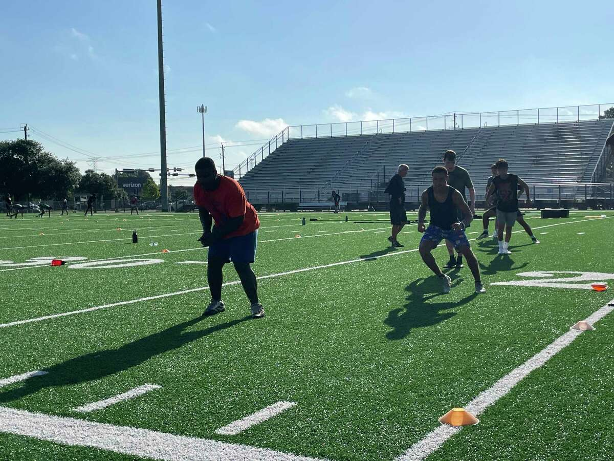 Spring Woods athletes perform agility drills during strength and conditioning camp on June 30
