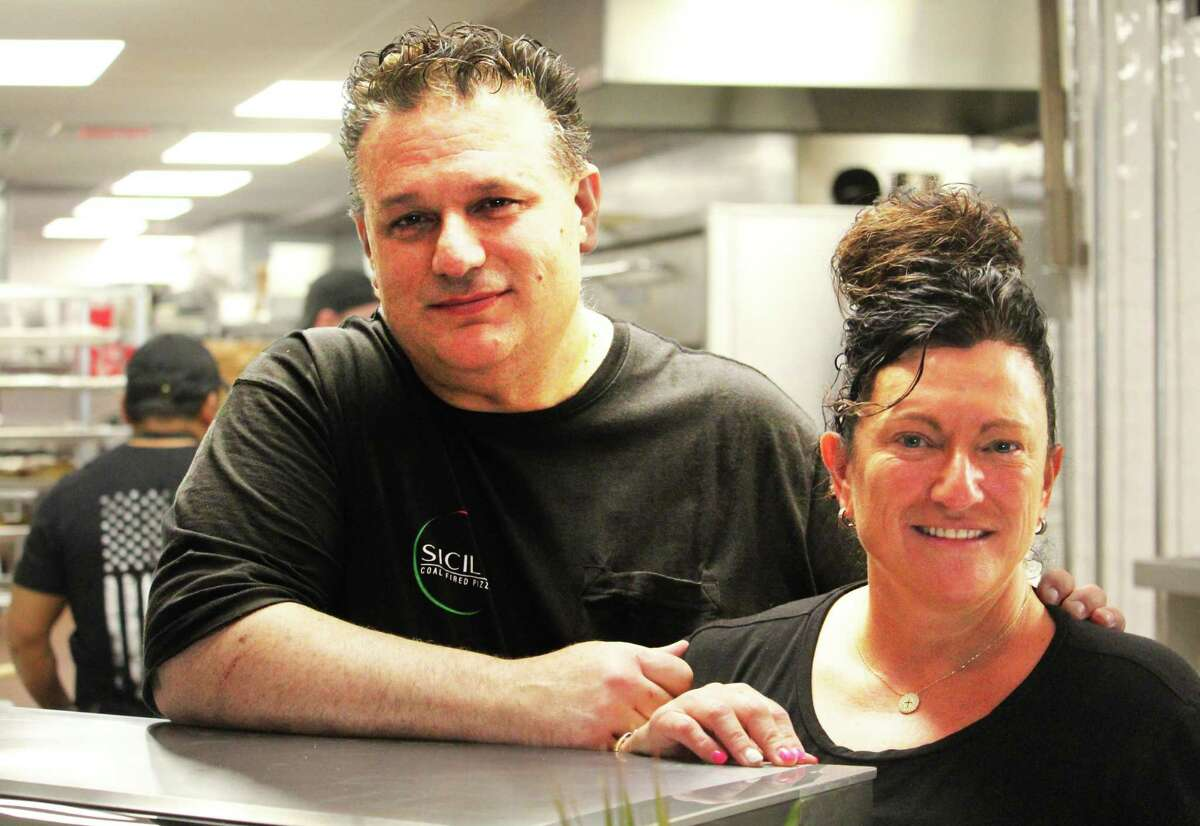Tony and Maria Prifitera launched Sicily Coal Fire Pizza at 412 Main St. in Middletown Monday in the old R.W. Camp's department store building. They want customers to know they serve much more than Italian pies in the 10,000-square-foot eatery.