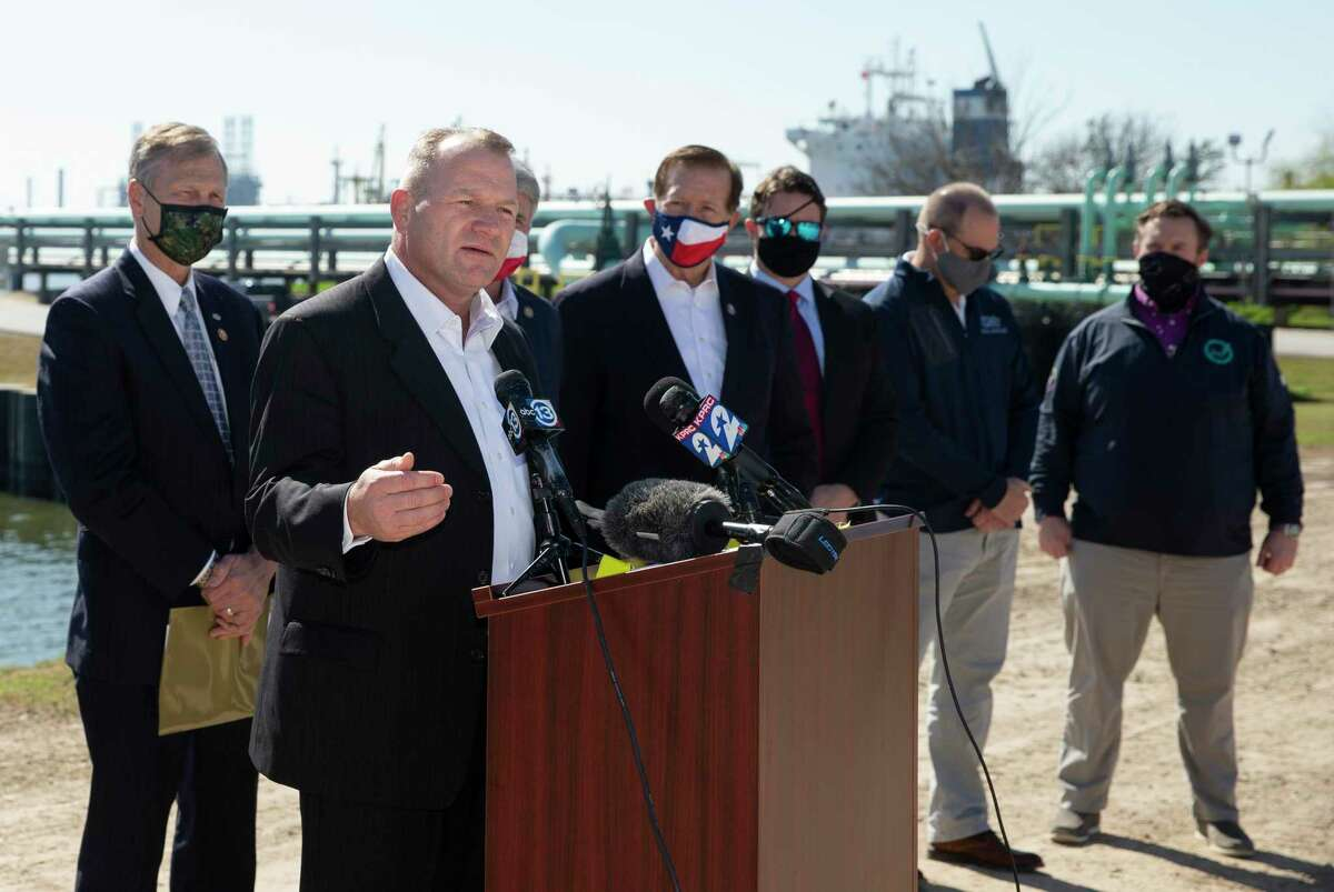 """U.S. Rep. Troy Nehls (at lectern) is shown at a Feb. 21, 2021 press conference at Houston Ship Channel. He said in a recent speech on the House floor that the recent spike in violent crime is due to """"liberal cities defunding and undermining their law enforcement,"""""""