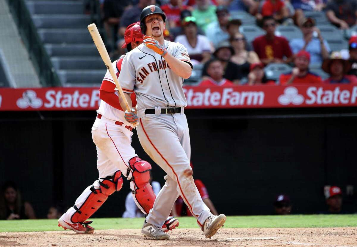 ANAHEIM, CALIFORNIA - JUNE 23: Alex Dickerson #12 of the San Francisco Giants reacts after striking out in the 10th inning against the Los Angeles Angels at Angel Stadium of Anaheim on June 23, 2021 in Anaheim, California. (Photo by Katelyn Mulcahy/Getty Images)