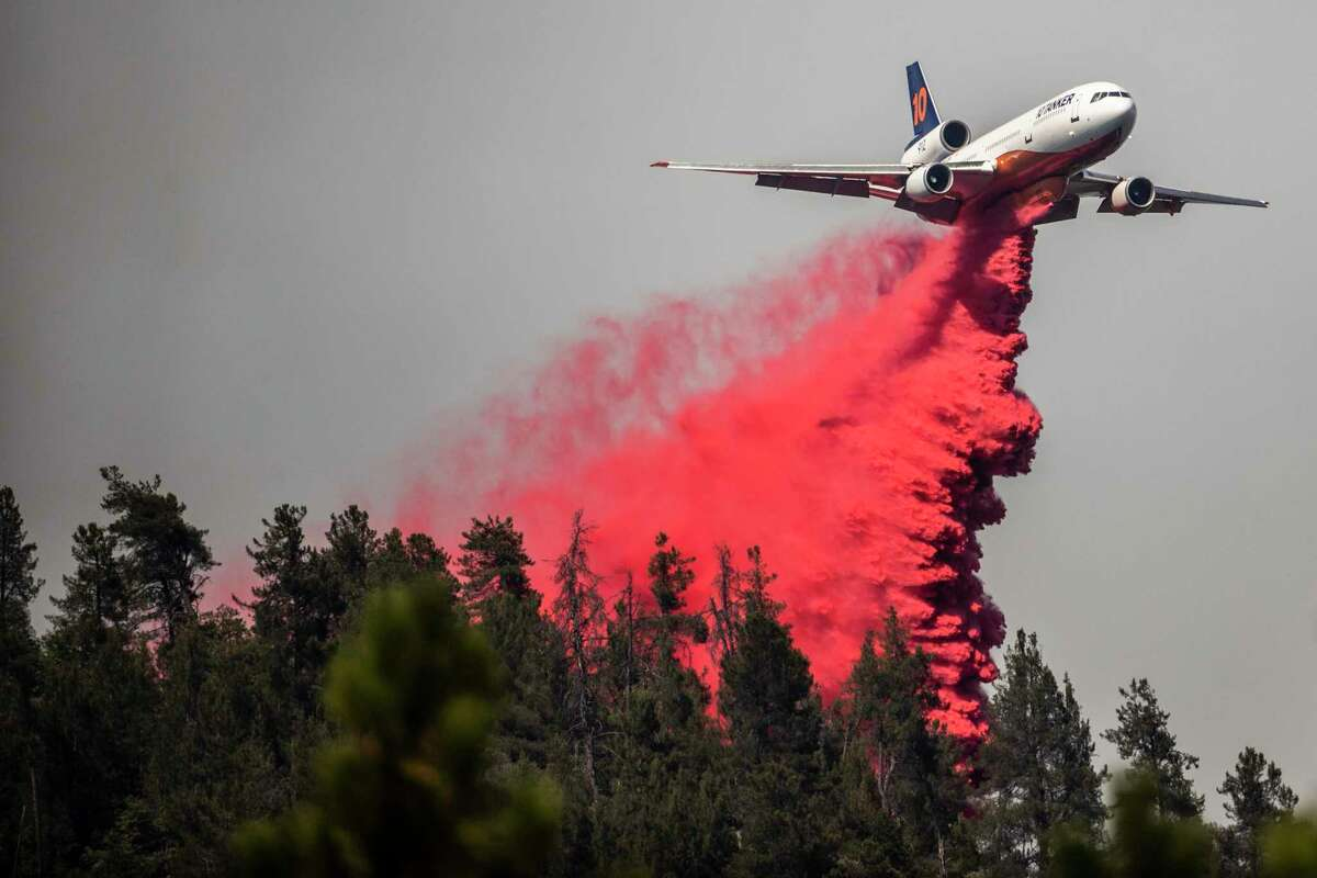 A DC-10 air tanker releases fire retardant while battling the Salt Fire.