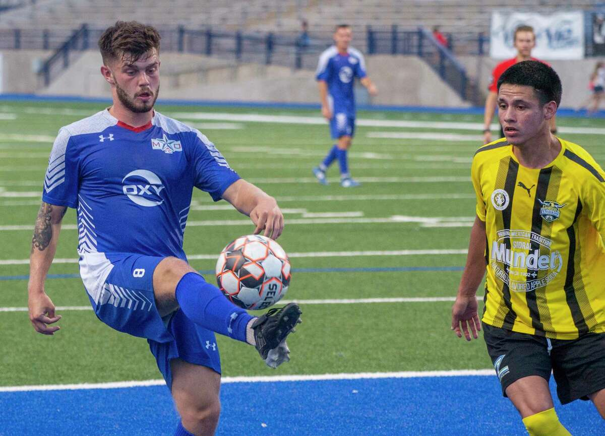Sockers' Cian Foley tries to control the ball as FW Vaqueros' Luis Martinez comes in to defend 07/02/2021 at Grande Communications Stadium. Tim Fischer/Reporter-Telegram