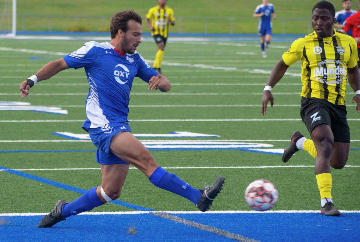 Sockers' Alonso Rodriguez passes the ball across the center as FW Vaqueros' Josemaria Oteze defends 07/02/2021 at Grande Communications Stadium. Tim Fischer/Reporter-Telegram