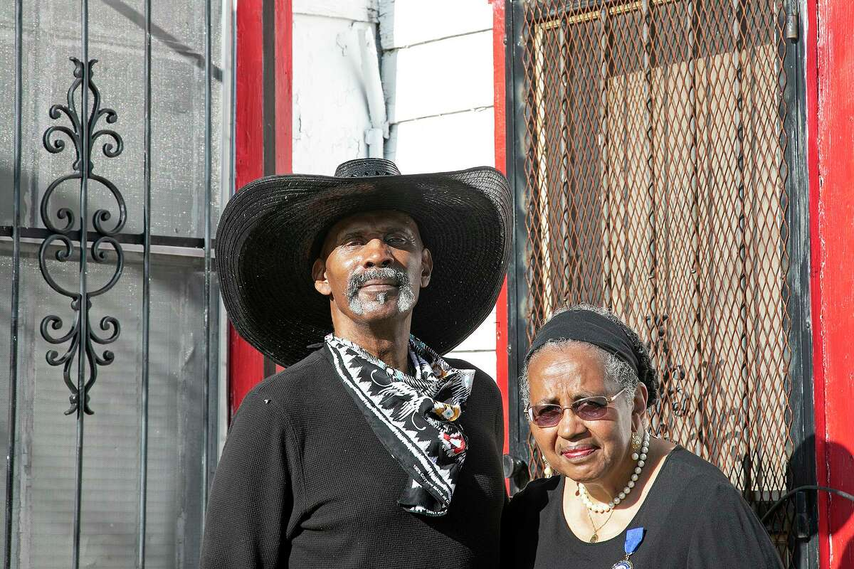 Ernest Stevenson Qadimasil II and his sister, Maria Stevenson Greene, stand outside the home where their grandparents lived with their mother in San Antonio on July 2, 2021. Their mother was born in the home in 1915.