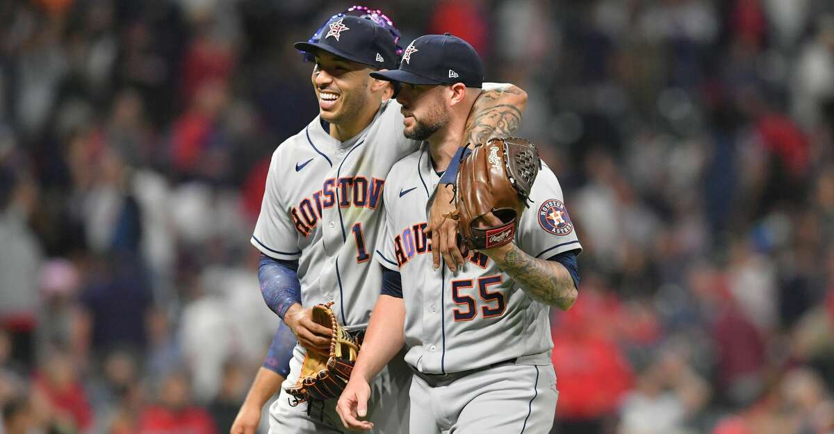 Carlos Correa #1 and closing pitcher Ryan Pressly #55 of the Houston Astros celebrate after the Astros defeated the Cleveland Indians at Progressive Field on July 02, 2021 in Cleveland, Ohio. The Astros defeated the Indians 6-3. (Photo by Jason Miller/Getty Images)