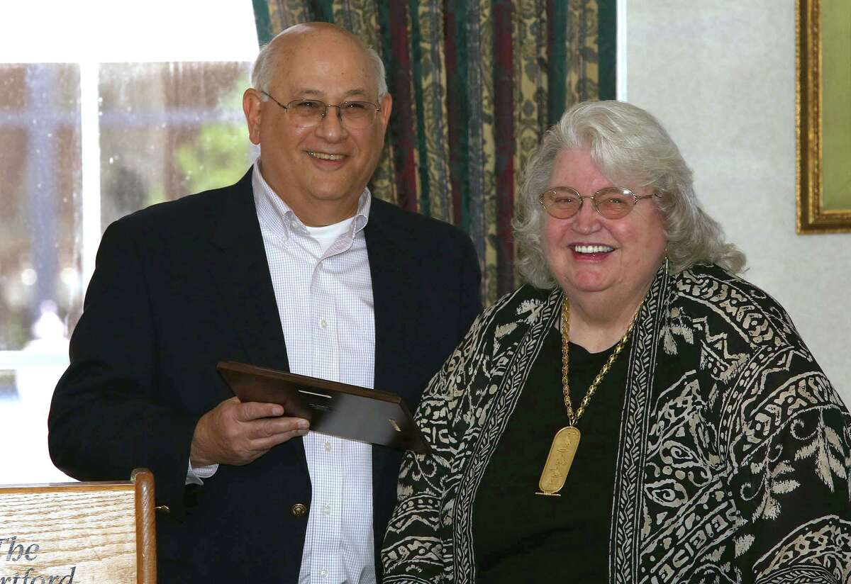 Former state Freedom of Information Commission member Norma Riess receives CCFOI's Champion of Open Government Award from CCFOI Executive Board member Mitchell Pearlman.